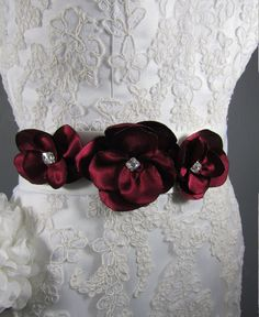 Marsala (red) floral sash with swarovski crystal centers https://www.etsy.com/listing/493828443/white-bridal-sash-marsala-red-floral