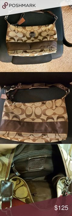 Authentic COACH bag Excellent condition and no wear.  The lining cloth has some stain as shown in the pictures. Everything else is excellent including hardware. Coach Bags Shoulder Bags