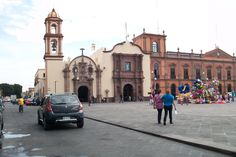 Downtown San Luis Potosi city. St. Martha and Virgin of Loreto catholic churches. At the right a colonial style ancient building that´s been used by the State University.