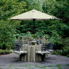 Who wouldn't love dining alfresco on a gorgeous day under a sleek, shade-producing umbrella? | Photo: Tria Giovan | thisoldhouse.com