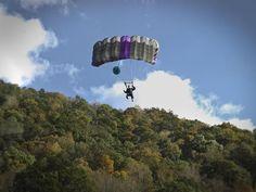 A BASE jumper in flight on Bridge Day