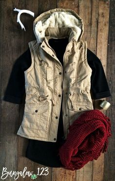 Fall in love with this perfect Fall/Winter Vest in Khaki featuring ultra-soft Sherpa lining with two front pockets. Detachable hood. Cotton/Poly blend. Model is wearing a size small. Also available in