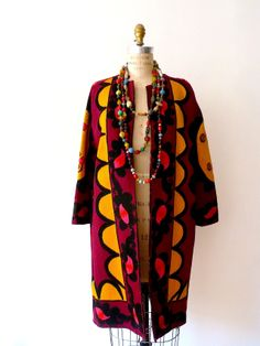 Not sure if id wear this. But a cool idea.Open Tunic Coat Made from Vintage Suzani Bokhara rug. One of a kind.