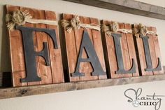 Fall-Decorating-Pallets and Chalkboards. Blogger added that her family wrote what they were thankful for on the letters. Awesome Idea!