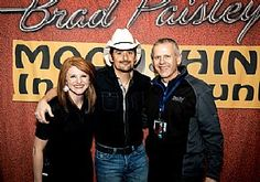 Kristina Lankow and Tom Richter welcome Brad Paisley to Swiftel Center in Brookings, S.D., Jan. 31.