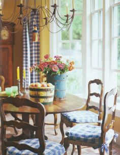 "Pretty blue checks, huge windows/door and yellow walls make this a ""happy"" breakfast room."