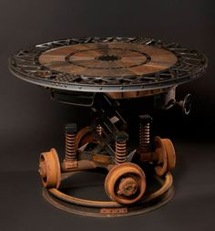 Industrial Revolution Table by artist Cory Barkman - Steampunk-ish coffee table. Should look perfect in the right setting but since it weighs in at I wouldn't recommend putting it upstairs… Furniture Projects, Cool Furniture, Furniture Design, Recycled Furniture, Furniture Plans, Furniture Movers, Furniture Chairs, Furniture Online, Metal Furniture