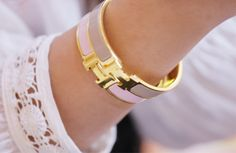 Hermes classic clic-clac bracelets always complement any outfit.