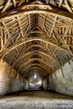 Interior of Tithe Barn, near Bath, England. Built in the early century. Timber vaulted ceiling typical example of medieval architecture.