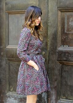Floral print dress and ombre/balayage highlights.