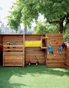 Unique but entertaining play structure. <3 the boy on the right looking into the neighbor's yard. Minimal square footage.