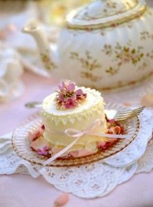 ❥ Individual rosewater cakes are served with a pot of herb tea.