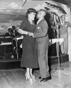 Billie Holiday dancing with the one and only Mr. Bojangles, Bill Robinson at Club Ebony at his 70th birthday celebration in 1948.