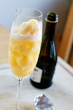 Orange Sorbet Mimosas--The Easy Way  1. One Scoop of Orange Sorbet in glass  2. Fill with Champagne  3. Drink!
