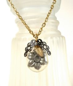 Pendant from pacifier nipple.