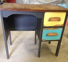A reimagined children's desk painted with super flat black and distressed