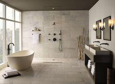 robinet design salle de bains avec baignoire ovale et douche italienne