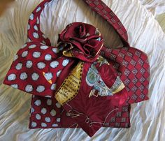 Three Neckties and a rosette