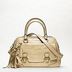 I rarely swoon over purses, but man I wish I could afford this Coach
