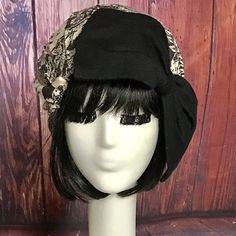 Borderline Hat- Black Lace Knit with Black Knit Bow a 1 elastic soft band inside. One size fits all and will fit up to a 23 head size or customized size upon request. SALE: $40.00 Regular Price: $50.00 All of Bella Starr hats are made and designed from my original patterns. Caring