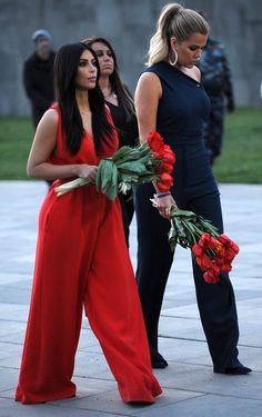 Pin for Later: We Just Can't Figure Out Kim's Latest Accessory Kim and Khloé donned contrasting colorful jumpsuits.