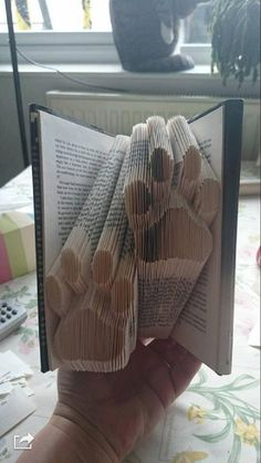 Double Paws Folded Book Pattern - 10 Awe-inspiring Book Folding Patterns All Book Lovers Will Appreciate