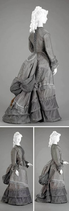 Walking suit, 1870s. Two-piece visiting dress in 2 shades of gray silk faille. Skirt has short train and is worn with bustle. Triangular pocket on right side of skirt, trimmed with buttons & cord lacing, was designed to hold parasol. Indianapolis Museum of Art