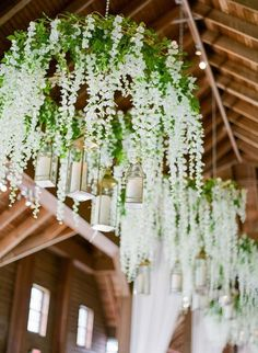 Prettiest spring wedding ideas---Hanging florals and greenery wedding decorations in the barn wedding venue of rustic county weddings. barn wedding Prettiest Ideas for A Unique Spring Wedding-Perfect Wedding Guide Diy Spring Weddings, Spring Wedding Decorations, Wedding Table Centerpieces, Flower Centerpieces, Centerpiece Ideas, Unique Weddings, Romantic Weddings, Beach Weddings, Handmade Wedding Decorations