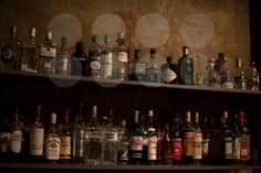 Bar shelves full of alcoholic beverages bottles - royalty free photos by franky242 photography - buy and download this photo online