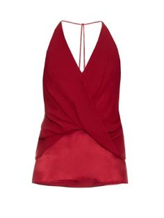 Dion Lee's scarlet-red cami is cut from fluid silk-satin to drape elegantly over the body. Cut with a deep-V halterneck, it twists gently across the front, and features ultra-slim straps that anchor the back. Team it with black trousers and towering heels after dark.