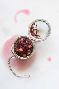 loose-leaf herbal tea made from hibiscus flowers and other herbs in a open strainer on a white counter White Tea Hibiscus Tea, Hibiscus Flowers, Food Styling, Herbal Tea Benefits, Herbal Teas, Best Matcha Tea, Tea For Colds, Peppermint Tea, Chamomile Tea