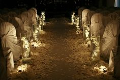 Wedding aisle decorations that would be great for an evening wedding.