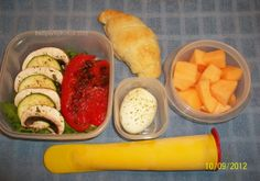 Veggie Croissant (layered lettuce, roasted red pepper, mushrooms and zucchini - pack roll separately to prevent sogginess), boiled egg, mandarin orange smoothie pop, and cantaloupe.