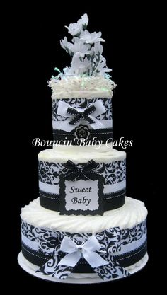 Cute but want to big..  loves this idea for a dipar cake so cute i would even make it bigger and more dramatic...blie and brown for my little man & purple and black for my little girl