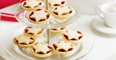 Update traditional festive fruit-mince tarts by filling them with a tempting combination of fresh raspberries and jam.