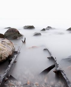 Nautical fine art photography of water, fog, and rocks. Seascape print of old pier rails. Lake house gift for doctor.