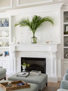 Love the palm fronds in vase look for mantel. Simple and coastal. Tropical Fireplace Mantels, Fireplace Mantle, Fireplace Design, Fireplace Ideas, Cozy Living Room Warm, Living Room Decor, Summer Mantel, Tropical Decor, Living Room