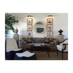 Biedermeier sette, ram arm chair, whicker lounge chair and ottoman, Limestone pedestals with one of a kind found pieces.   Amy Meier Design Studio - Rancho Santa Fe, CA