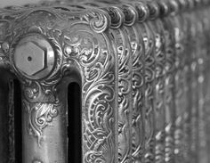 Close up of the Rococo Cast Iron Radiator in the Hand Burnished finish