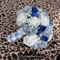 Royal blue and silver combination with white roses http://www.thebridalflower.com/grand-royal