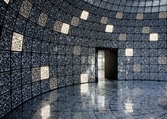Every surface inside the top floor of the Russian Pavilion at the Venice Architecture Biennale is covered in QR codes, which visitors decode using tablet computers to explore ideas for a new Russian city dedicated to science.