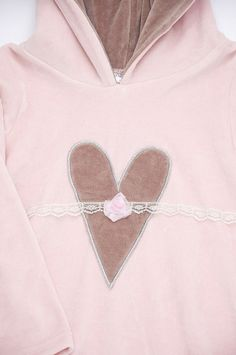 """myCinnamonGirl - Rosie Dress  This cozy velour hoodie dress has been a girl's """"must have"""" for years. This season we have added even more of the vintage inspired colours to suit every CinnamonGirl. The dress features the signature heart in the front with rose and lace details."""