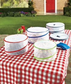 The Pop-Up Food Cover Sets prevent insects and dirt from touching your food. The sides extend straight up so you can store layered cakes, bowls and other large serving pieces underneath. They feature handles on the tops so they're easy to lift. Each cove