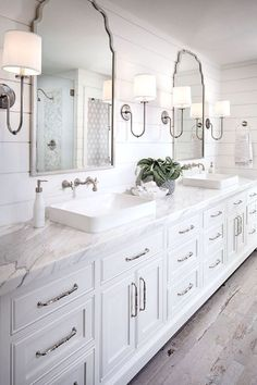 Shiplap bathroom wall with white cabinetry, white marble countertop, wall mount faucet and rustic looking floor tile. shiplap-bathroom-wall-with-white-cabinetry-and-rustic-looking-floor-tile Tracy Lynn Studio Shiplap Bathroom Wall, Rustic Master Bathroom, Bathroom Vanity Decor, Modern Bathroom Design, Bathroom Interior Design, Bathroom Mirrors, Master Bathrooms, Bathroom Lighting, Bathroom Cabinets