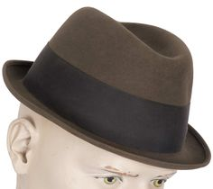 "This is a wonderful Trilby style fedora hat made by Stetson of Canada as part of the ""Royal Stetson"" line. I've photographed the narrow brim in an upturned pose, but it could be worn down at the front"