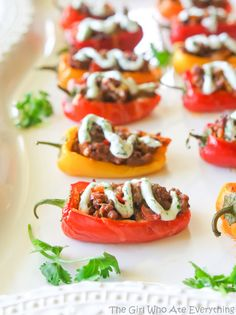 Mini Taco Stuffed Peppers - mini bell peppers stuffed with taco meat and drizzled with a cilantro cream sauce. {The Girl Who Ate Everything}