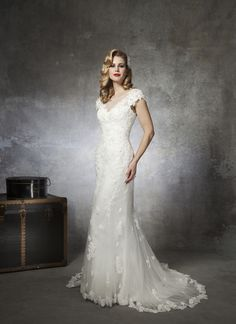 Justin Alexander wedding dresses style 8658 Sequins, pearls, and bugle beads trim this tulle Sabrina neckline and  accent the cap sleeves on this Venice lace and tulle mermaid gown. The  V-back is complemented by buttons that cover the back zipper and this  style has a chapel length train.