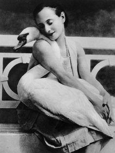 Anna Pavlova + her pet swan Jack, 1905! Per Google: Anna was premier Russian ballerina, born 1881. In 1912 she moved to London. Lived in Ivy House, on North End Road, Golders Green, north of Hampstead Heath. Lived there until her death in1931. Created ballerina's dance role of The Dying Swan!! Ivy House had a pond where she kept all of her pet swans!