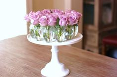 Roses on cake stand with table number in middle?