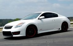 Nissan Altima Coupe with red accents I'm in love